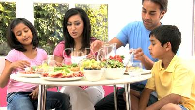 Young Ethnic Family Eating Healthy Lunch Together