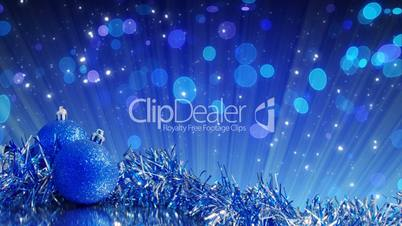 blue christmas tree decoration and glitter particles loop