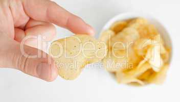 Hand with potato chip