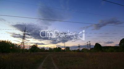powerlines in sunset. timelapse.