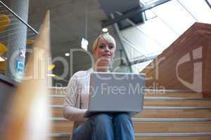 young blond woman with laptop