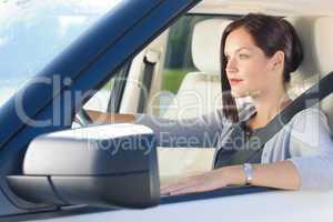 Attractive businesswoman drive luxury car