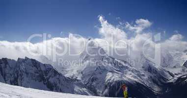 Panorama Mountains. Ski slope with skier.