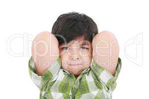 Close up portrait of a young boy child smiling with arms up behi