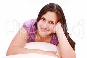 Portrait of cute young girl laying down in her bed