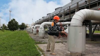 worker twists closing valve