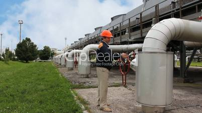 worker twists opening valve