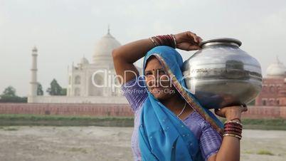 Indian Woman wearing Sari in front of Taj Mahal