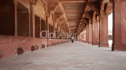 Indian Man walking corridor at Fatehpur Sikri