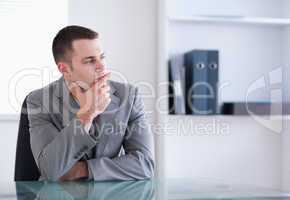Businessman thinking and sitting