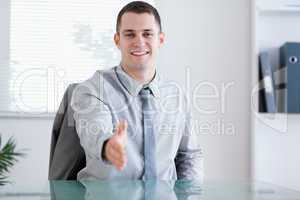 Smiling businessman greeting his negotiation partner