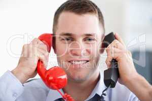 Close up handling the telephone stress smiling