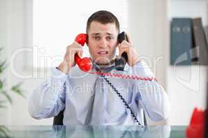 Businessman unable to cope the telephone