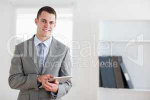 Smiling businessman with his notes