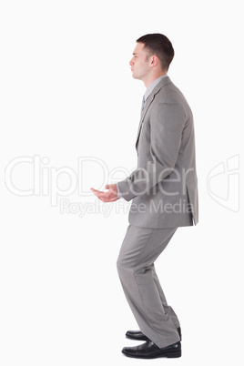 Portrait of a businessman carrying something