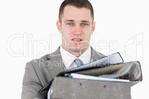 Overwhelmed young businessman