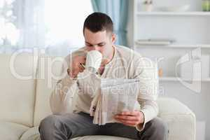 Man reading the news while drinking a tea