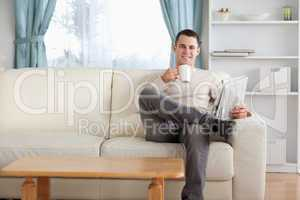 Man having a tea while reading the news