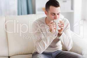 Good looking man having a tea