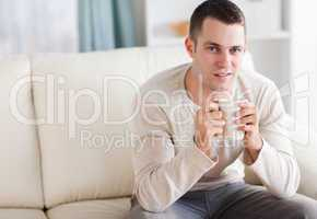 Good looking man having a coffee