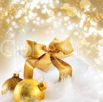 Gold ribboned gift with holiday background