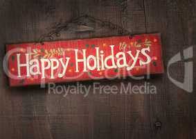 Holiday sign on distressed wood wall