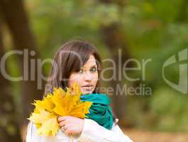 Beautiful woman portrait with yellow leaf