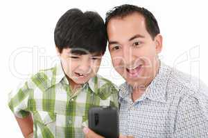 Young father and son was surprised, having read on mobile phone