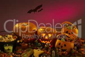 Halloween party decorations with carved pumpkins