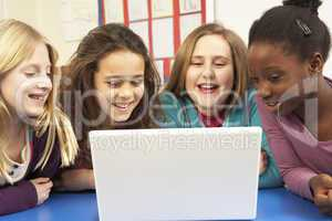 Group Of Schoolgirls In IT Class Using Computer