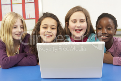 Group Of Schoolgirls In IT Class Using Computer