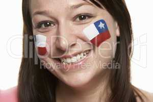 Young Female Sports Fan With Chilean Flag Painted On Face
