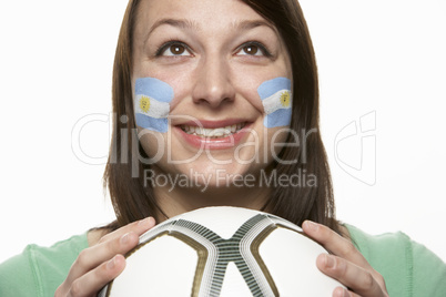 Young Female Football Fan With Argentinian Flag Painted On Face