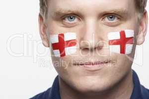 Young Male Sports Fan With St Georges Flag Painted On Face