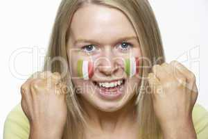 Young Female Sports Fan With Italian Flag Painted On Face