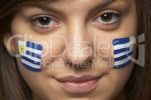 Young Female Sports Fan With Uruguayan Flag Painted On Face