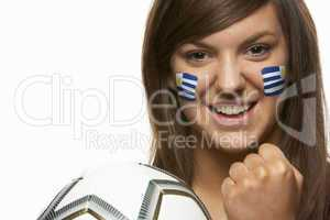 Young Female Football Fan With Uruguayan Flag Painted On Face