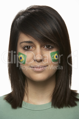 Young Female Sports Fan With Brazilian Flag Painted On Face