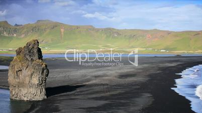 Lone Figure Watching Arctic Waves & Volcanic Ash Beach