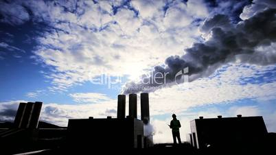 Engineer in Silhouette at Geothermal Power Station
