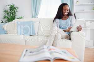 Woman with her tablet on couch