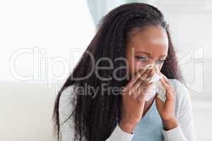 Close up of woman blowing her nose
