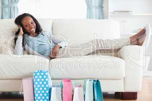 Woman putting her feet up after shopping