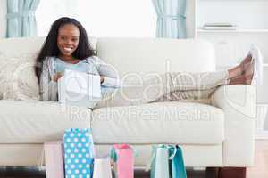 Young woman putting her feet up after shopping