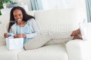 Woman taking a rest on the sofa after shopping