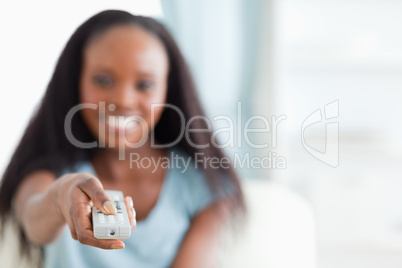 Close up of remote control being used by woman