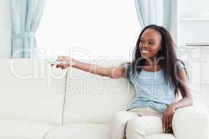 Woman in living room with remote control