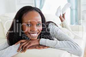 Woman releasing tension on sofa