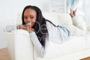 Woman having a moment of relaxation on sofa