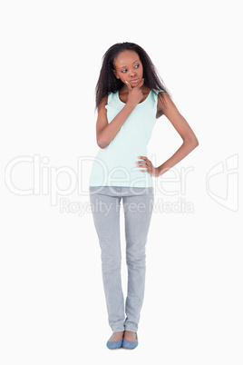 Young woman thinking on a white background